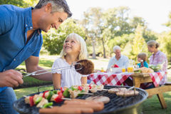 Happy father doing barbecue with her daughter Royalty Free Stock Photos