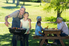 Happy father doing barbecue with his daughter Royalty Free Stock Photo