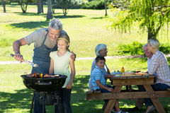 Happy father doing barbecue with his daughter Royalty Free Stock Photography