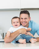 Happy father embracing baby Royalty Free Stock Images