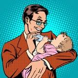 Happy father feeding newborn baby with milk Stock Photos