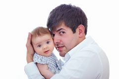 Happy father gently holding baby daughter Stock Image