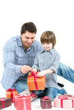 Happy father gives his son gift isolated on white. Royalty Free Stock Photos