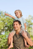Happy father giving son a piggyback Royalty Free Stock Photo