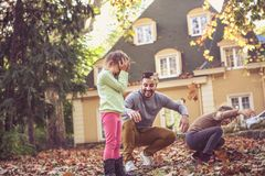Happy father have play with girls. On the move. royalty free stock images