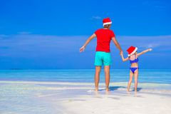 Happy father and his adorable daughter in Santa Royalty Free Stock Photo
