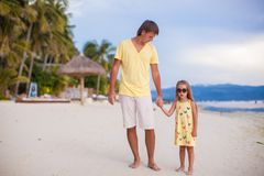 Happy father with his adorable daughter walking on Stock Images