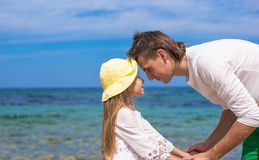 Happy father and his adorable daughter at white Royalty Free Stock Photos