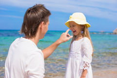 Happy father and his adorable daughter at white Stock Photos