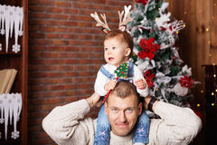 Happy father and his adorable little daughter among Christmas de Stock Images