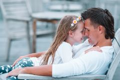 Happy father and his adorable little daughter relax at tropical vacation stock images
