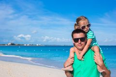 Happy father and his adorable little daughter together at the beach Stock Photography