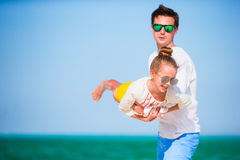 Happy father and his adorable little daughter at tropical beach. Caucasian family having fun together on suumer vacation Royalty Free Stock Photography