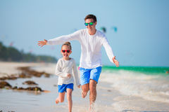 Happy father and his adorable little daughter at tropical beach. Caucasian family having fun together on suumer vacation Royalty Free Stock Photos
