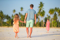 Happy father and his adorable little daughter at tropical beach. Caucasian family having fun together on suumer vacation Stock Images
