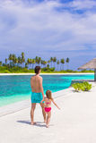 Happy father and his adorable little daughter at tropical beach having fun Stock Images