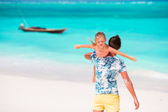 Happy father and his adorable little daughter at tropical beach having fun Royalty Free Stock Photography