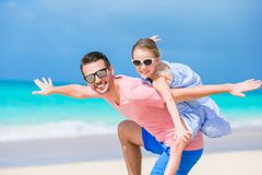 Happy father and his adorable little daughter at tropical beach having fun. Together Royalty Free Stock Photos