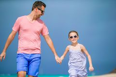 Happy father and his adorable little daughter at tropical beach having fun. Together Royalty Free Stock Photography