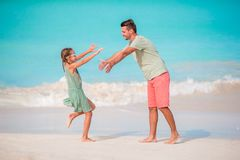 Happy father and his adorable little kid at tropical beach having fun. Happy father and his adorable little daughter at tropical beach having fun together Royalty Free Stock Photography