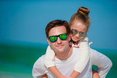 Happy father and his adorable little daughter at tropical beach having fun Stock Image