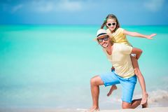 Happy father and his adorable little kid at tropical beach having fun together. Happy father and his adorable little daughter at tropical beach having fun Stock Photos