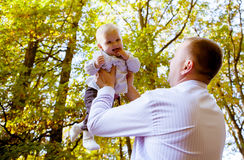 Happy father and his baby. Daughter having fun in the park Royalty Free Stock Photography