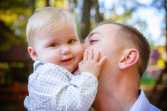Happy father and his baby. Daughter having fun in the park Royalty Free Stock Images