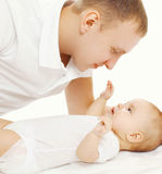 Happy father with his baby on the bed Stock Photos