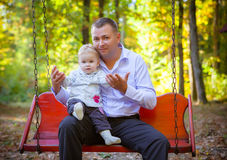 Happy father and his baby daughter. Having fun in the park Royalty Free Stock Photos