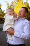 Happy father and his baby daughter. Having fun in the park Royalty Free Stock Photo