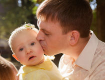 Happy father and his baby daughter having fun. In the park Stock Photo