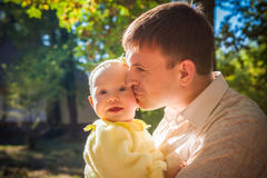 Happy father and his baby daughter having fun. In the park Stock Images