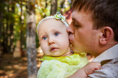 Happy father and his baby daughter having fun. In the park Royalty Free Stock Image