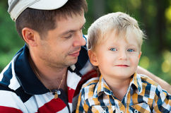 Happy father and his baby son having fun. In the park outdoor Stock Photos