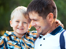 Happy father and his baby son having fun in the park Stock Photos