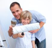 Happy father and his boy renovating home Royalty Free Stock Image