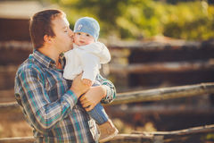 Happy father with his child faving fun in uemmer day outdoors. Stock Photo