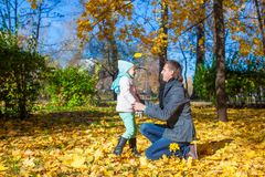 Happy father with his cute daughter in autumn park Stock Images