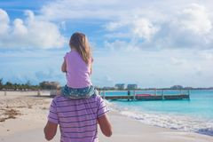 Happy father and his cute little daughter at beach Royalty Free Stock Photos