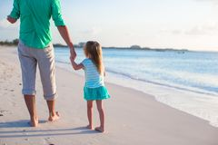 Happy father and his cute little daughter at beach Royalty Free Stock Image