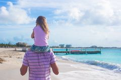 Happy father and his cute little daughter at beach Stock Photo