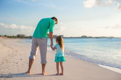 Happy father and his cute little daughter at beach Stock Photos