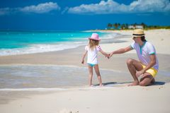 Happy father and his cute little daughter at beach Stock Image