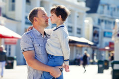Happy father and his cute little son outdoors Royalty Free Stock Images