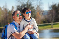 Happy father and his cute little son outdoors Stock Photography