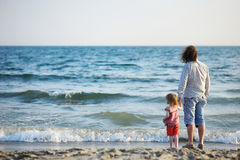 Happy father with his daughter on a beach Stock Images