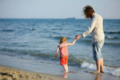 Happy father with his daughter on a beach Royalty Free Stock Image