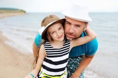 Happy father and his daughter at beach Stock Photography