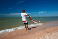 Happy father and his daughter at the beach having fun.  royalty free stock image